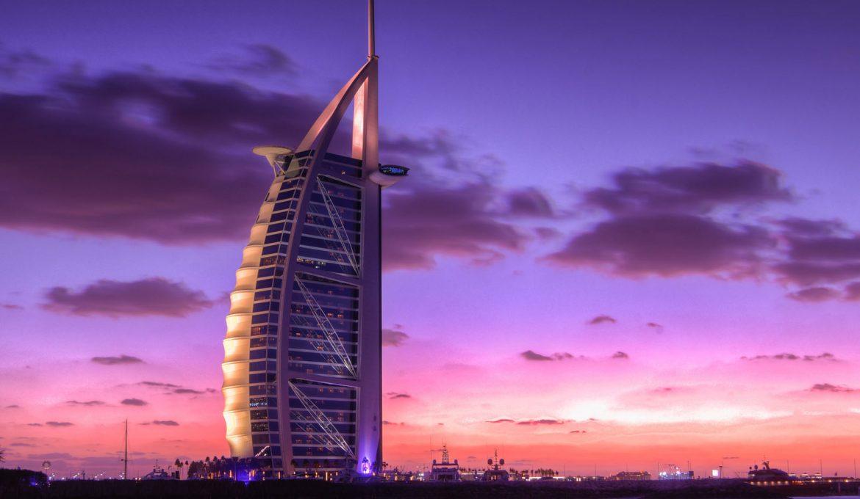 A sunset shot of the Burj Al Arab in Dubai